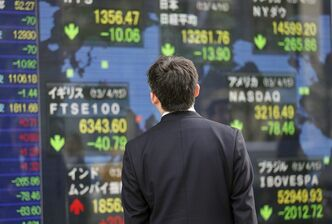 A man looks at an electronic stock indicator in Tokyo, Tuesday, April 16, 2013. Asian stock markets were mostly lower Tuesday as weak economic data, falling commodity prices and big losses on Wall Street shook investors. A deadly bombing in the U.S. also rattled confidence.(AP Photo/Shizuo Kambayashi)
