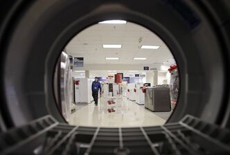 In this Dec. 6, 2012 photo, an employee walks through the appliance department at a Sears in North Olmsted, Ohio. THE CANADIAN PRESS/AP, Mark Duncan