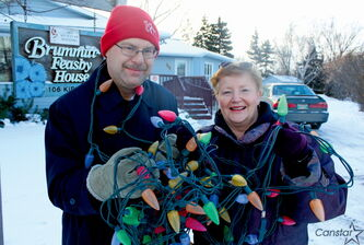 Got a light? Brian Campbell and Diana Rasmussen of the ALS Society of Manitoba are hoping to raise $4,000 during this year's Lite Up A Life campaign.