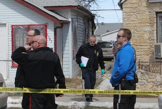 Police officers investigate a suspicious death in the 1100 block of Alexander Ave. Saturday afternoon.