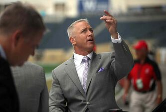 Former Blue Bomber quarterback Matt Dunigan suited up a little differently for the Bombers' home opener on June 26, 2014.