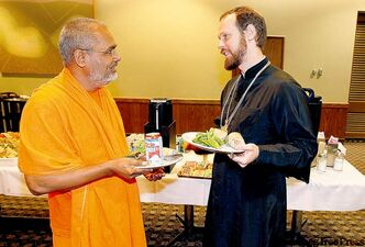 Swami Parmatmandi from India with Rev. Hegumen Philip Ryabkh, a Russian Orthodox clergyman.