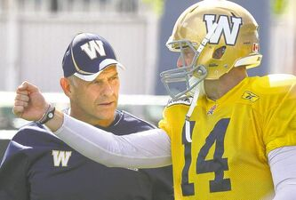 Blue Bombers offensive co-ordinator Gary Crowton and quarterback Joey Elliott talk shop at Thursday's workout.