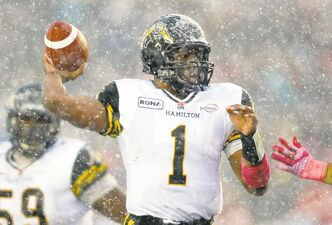 It's beginning to look a lot like... football! Ticats QB Henry Burris looks for a pass through a Calgary snowstorm Saturday. Ticats came close but missed a winning field goal on the last play.