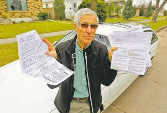 BORIS MINKEVICH / WINNIPEG FREE PRESS  Yehuda Tcherni with the documents from the city. He's vowing to fight the fines and tow he received on Queenston Bay.