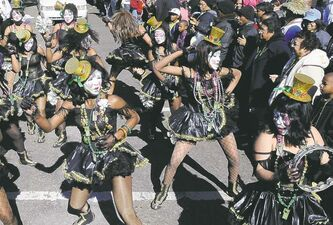 @None:This 2010 photo provided by Jeffry Dupuis shows the Baby Doll Ladies performing in the Zulu krewe parade on Mardi Gras in New Orleans. Baby dolls -- groups of women in skimpy or short, ruffled dresses -- started with one group of African-American prostitutes wanting to one-up another on Mardi Gras 1912, but spread within decades to respectable black neighborhoods. The tradition had died out, but is seeing a modern revival.
