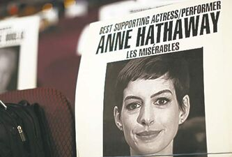 Seating placard holds spot for Les Miserables stars Hathaway and Jackman (below).