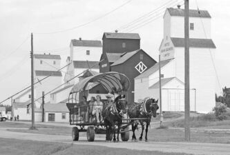 A horse-drawn carriage takes visitors past the grain elevators that put Inglis on the map.