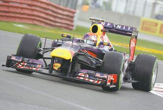 Red Bull driver Sebastian Vettel of Germany drives through the final chicane on his way to winning the pole during Saturday qualifying.