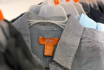 A Joe Fresh garment made in Bangladesh is shown at a Loblaws outlet in Montreal, Thursday, April 25, 2013. Loblaw Inc.says it will provide compensation for the families of victims who worked in the collapsed Bangladeshi garment factory which made products for its Joe Fresh clothing line.THE CANADIAN PRESS/Graham Hughes