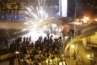 Supporters and opponents of Egypt's deposed president, Mohammed Morsi, clash in Cairo on Friday.