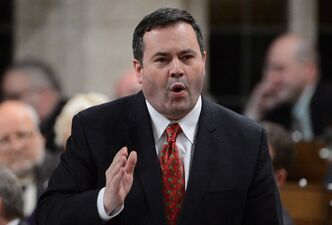 "Minister of Immigration Jason Kenney answers a question during question period in the House of Commons on Parliament Hill in Ottawa on Monday, December 3, 2012. Five groups of recently arrived Romanian nationals are suspected by Canadian border officials of being part of a human smuggling ring. Fifty adults and 35 children who came to Canada since February have now been classified as ""irregular arrivals."" THE CANADIAN PRESS/Sean Kilpatrick"