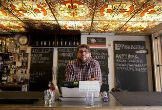 Lo Pub owner Jack Jonasson at the bar Saturday — the last night Lo Pub will be open.
