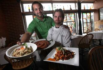 Mona Lisa's Angelo Anania (left) serves Pasta Carbonara Alla Roma and chef James McIlwain shows off platters of Calabrese sausage links and Salasicce Calabrese.