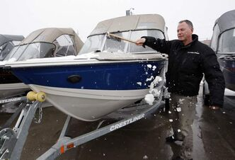 Rond's Marine sales manager Jeff Snowdon says people are still buying boats but the cold spring is slowing sales down.