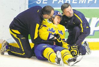 Viktor Arvidsson of Sweden receives treatment after being hit by a Team Canada player on Saturday.