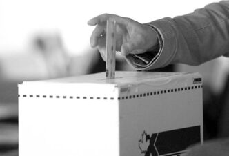 A man casts his vote in the 2011 election in Toronto.
