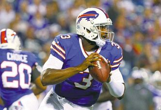 Buffalo Bills quarterback EJ Manuel looks to pass during the second half of a preseason game against the Minnesota Vikings on Friday in Orchard Park, N.Y.  Manuel will miss the remainder of the preseason with an injured knee.