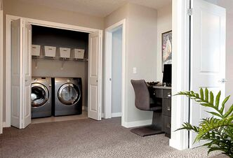 The upstairs landing is exceptionally wide with access to the laundry area and a desk niche.