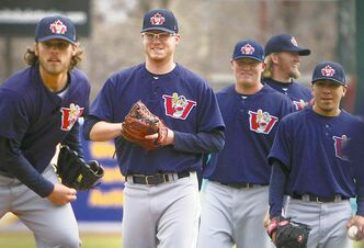 Rookie Goldeyes pitcher David Hatt (second from left) is one of two Canadians in camp now.