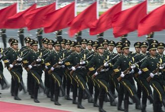 Chinese honor guards march during a welcome ceremony for Iceland's Prime Minister Johanna Sigurdardottir outside the Great Hall of the People in Beijing Monday, April 15, 2013. (AP Photo/Andy Wong)