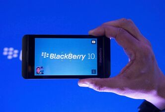 A new BlackBerry Z10 is held up during the global launch of the company's new smartphones in Toronto on Wednesday, Jan. 30, 2013. BlackBerry reports profit of US$98 million or 19 cents per share for quarter ended March 2 compared with $125 million or 24 cents per share loss a year ago. THE CANADIAN PRESS/Nathan Denette