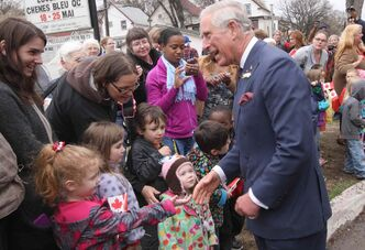 Prince Charles speaks to onlookers after visiting Place Bernadette Poirer during his trip to Winnipeg.
