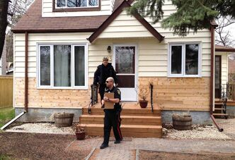 Winnipeg police Constables John Simoes and Michelle Hiebert were among the several officers and cadets out canvassing homes in River Heights Wednesday to warn residents of the annual spike in property crimes in the area.