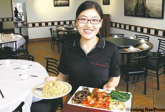 Wenyang Xiong, a waitress at Dim Sum Garden, with fried rice dish (left) and a combo plate with sweet and sour pork, beef short ribs, yu choy and fried egg.