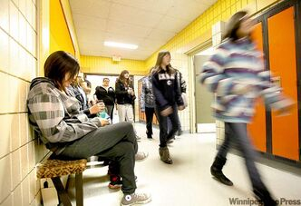 High School students make their way to class after lunch hour at Ebb and Flow School.