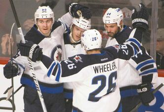 Blake Wheeler celebrates a recent goal with his Jets teammates. The forward says his team is now fulfilling the potential it has always had.