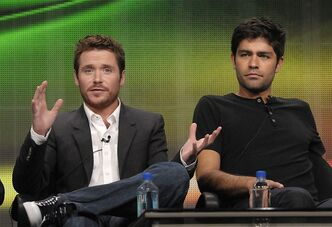 "FILE - In this July 28, 2011 file photo, actor Kevin Connolly, left, and actor Adrian Grenier speak during The Television Critics Association 2011 Summer Press Tour in Beverly Hills, Calif. Grenier and Connolly star in the series ""Entourage"" on HBO. Warner Bros. confirmed Wednesday, Jan. 30, 2013, that a film version of HBO's hit series ""Entourage"" is in the works. (AP Photo/Dan Steinberg, File)"