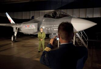 A Canadian Forces pilot has his picture taken in front of a F-35 Strike Fighter prior to an announcement in Ottawa, Friday July 16, 2010. A detailed report crunching all of the numbers, contingencies and eye-popping price points of the Harper government's cherished stealth fighter program is due to be officially made public Wednesday, but experts say it may have a short shelf life as the U.S. heads for its so-called fiscal cliff. THE CANADIAN PRESS/Adrian Wyld