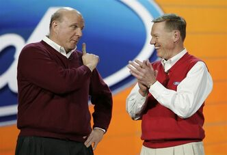 FILE- In this Thursday, Jan. 8, 2009, file photo, Ford Motor Company CEO and president Alan Mulally, right, listens to Microsoft CEO Steve Ballmer, left, during Mulally's keynote address at the International Consumer Electronics Show (CES) in Las Vegas, Mulally said Tuesday, Oct. 8, 2013, he's made no changes to his plan to stay at Ford through the end of 2014. But he hasn't denied rumors that Microsoft Corp. is courting him. (AP Photo/Paul Sakuma File)
