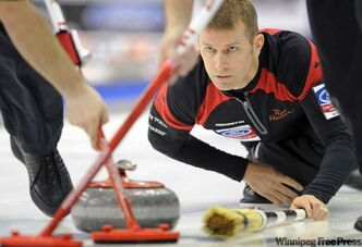 Team Canada skip Jeff Stoughton throws his rock against team Switzerland in the opening draw of the world men's curling championships on Saturday in Regina.