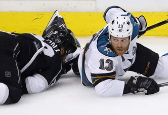 San Jose Sharks left-winger Raffi Torres (13) looks up after hitting Los Angeles Kings centre Jarret Stoll during Game 1 of their series.