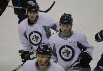 Mark Scheifele (left) and Jacob Trouba didn't play like rookies Tuesday night in Edmonton.