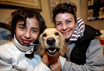 Pooch Talia, who'd been lost in the barrens (or Winnipeg, as we call it) since Dec. 27, was reunited with her emotional family Thursday night.  Here Carolina Villa, 11, poses with Talia and with Lois Reid, who stopped in traffic to scoop up the lost and disoriented Colombian pup.
