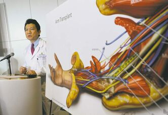 W.P. Andrew Lee, M.D. talks about the bilateral arm transplant on Infantryman Brendan M. Marocco during a news conference Tuesday, Jan. 29. 2013 at Johns Hopkins hospital in Baltimore. Marrocco received a transplant of two arms from a deceased donor after losing all four limbs in a 2009 roadside bomb attack in Iraq. (AP Photo/Gail Burton)