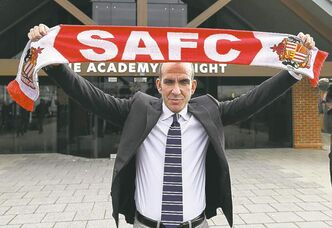 Sunderland manager Paolo Di Canio has renounced his links to fascism,  but criticism of his appointment remains.