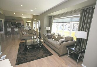 Finishes in the great room include engineered honey maple hardwoods with a whitewashed tinge.