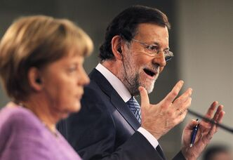 Germany's Chancellor Angela Merkel, left, and Spain's Prime Minister Mariano Rajoy, right, gesture during a press conference at the Moncloa Palace, in Madrid, Spain, Thursday, Sept. 6, 2012. (AP Photo/Andres Kudacki)