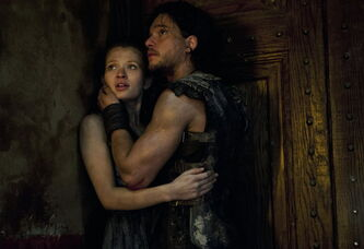 "Emily Browning, left, and Kit Harington star in ""Pompeii."""