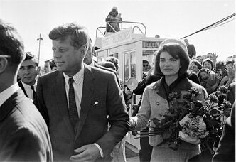 FILE - This Nov. 22, 1963 file photo shows President John F. Kennedy and his wife Jacqueline Kennedy upon their arrival at Dallas Airport, in Dallas, shortly before President Kennedy was assassinated. PBS says its fall schedule will include a variety of specials marking President John F. Kennedy's death 50 years ago. In the weeks leading up to the milestone anniversary of his Nov. 22, 1963, slaying in Dallas, PBS said it will air