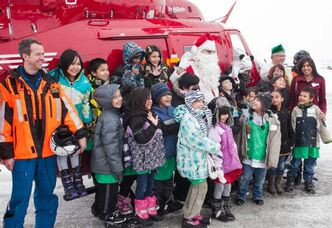 Students from Dufferin School pose with Santa Claus and part of the STARS Air Ambulance team at the Winnipeg Airport firehall on Monday afternoon. 150 students were surprised by Santa's arrival on the STARS helicopter.