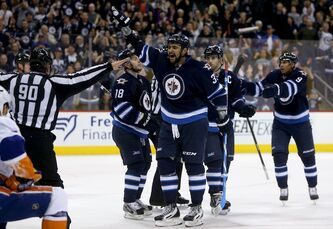 Winnipeg Jets' Dustin Byfuglien reacts to a disallowed goal after time expired at the end of the second period in Saturday's game against the New York Islanders.