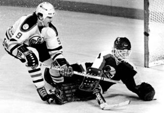 Oiler speedster Glenn Anderson is thwarted by Jets goaltender Brian Hayward in Edmonton on Feb.27, 1983. Edmonton would sweep Winnipeg three straight in the playoffs later that season.