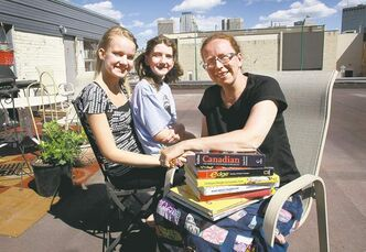 WAYNE GLOWACKI / WINNIPEG FREE PRESS Francine Wiebe moved her family -- including daughters Katie, 12 (centre), and Alexandra, 14 -- so she could home-school African immigrant kids.