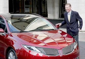 Ford Motor Co. president and CEO Alan Mulally stands next to a Lincoln MKZ at a recent press conference. Seven new or revamped Lincolns will go on sale by 2015.