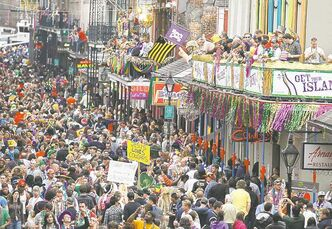 Crowds congregate on Bourbon Street.
